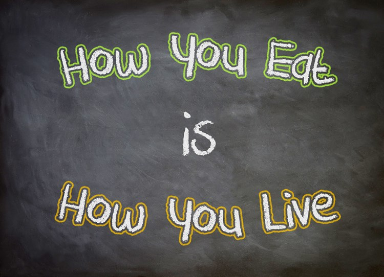 "Text on a chalkboard that reads ""how you eat is how you live"""