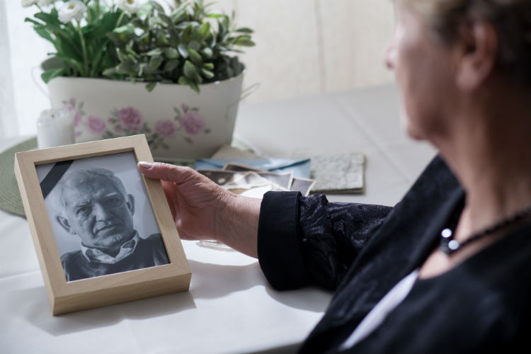 Woman staring at loved one's picture who passed away