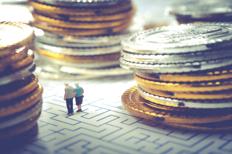 Figurine of older couple going through financial maze
