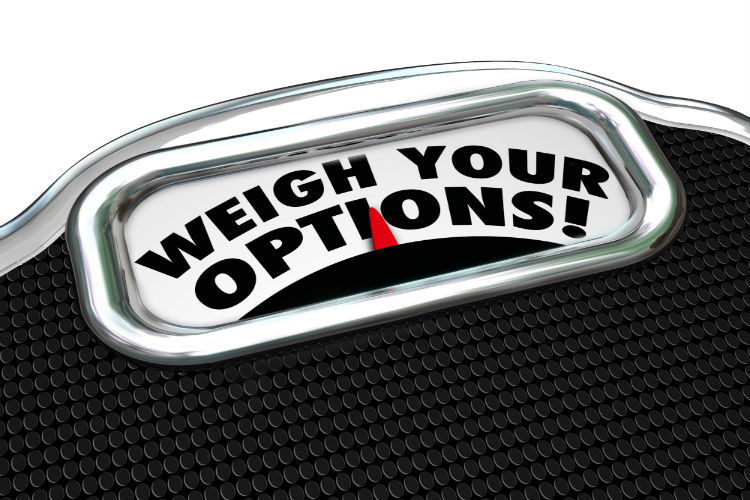 "A weight scale that has text in the middle that reads ""weigh your options"""