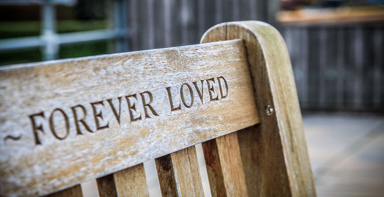 """A memorial bench that says """"forever loved"""""""