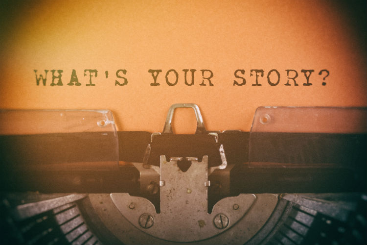 "Typewriter with ""What's Your Story"" typed on a piece of paper"