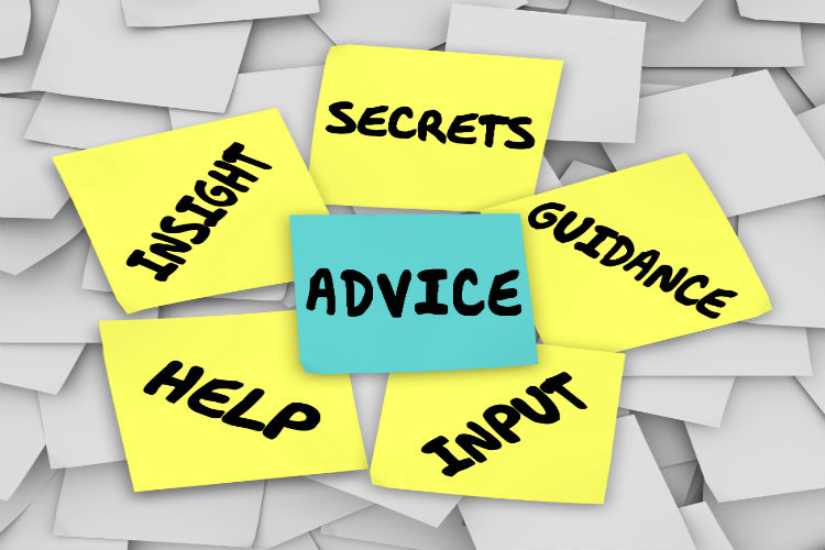 "A post it note with the word ""advice"" written on it surrounded by other post it notes that read ""secrets,guidance,insight,help,input"""