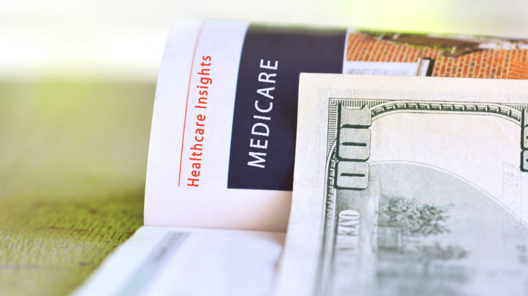 """Magazine headline that says """"Medicare"""" with a $100 bill"""