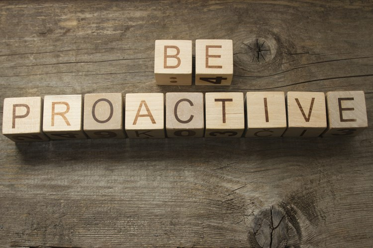 "Letter blocks that spell out ""be proactive"""