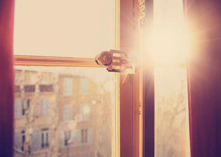 Vintage window with sun shining through