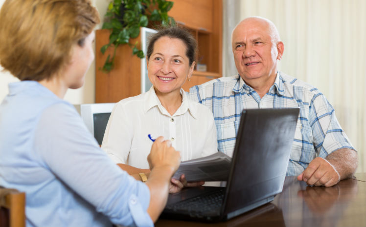 A social worker discussion options with a senior couple