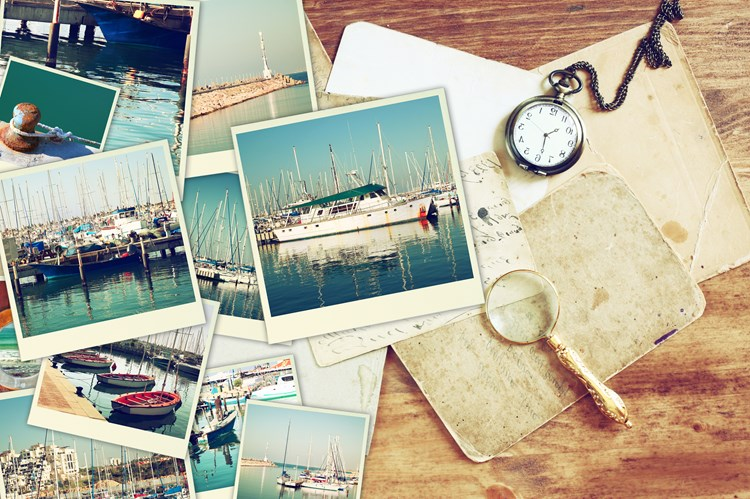 Polaroid pictures of bucket list locations laid out on a desk