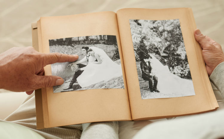 Elderly couple looking at old wedding photos