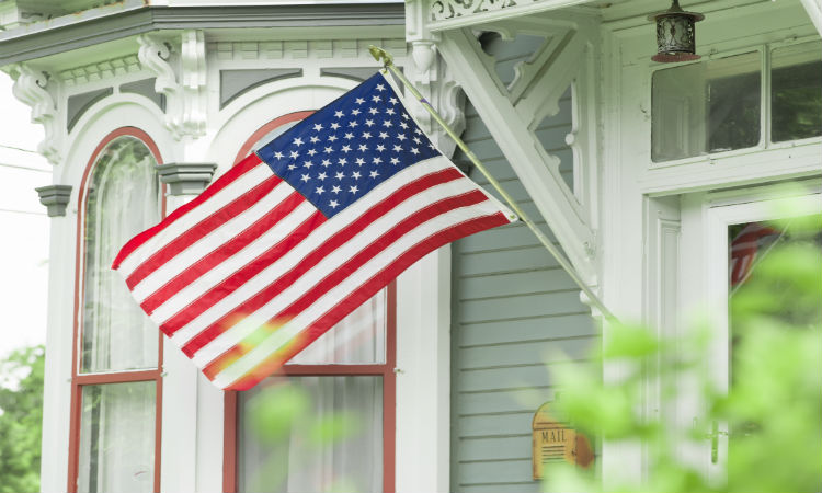 American flag hanging outside a home