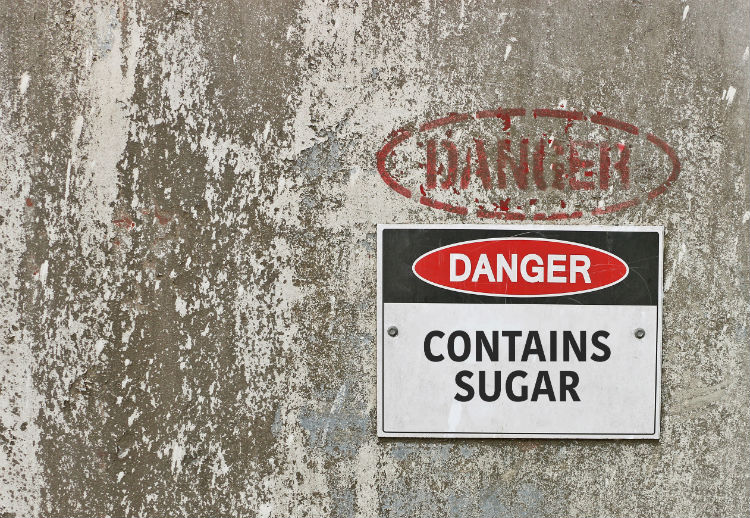 Warning sign that says danger: contains sugar