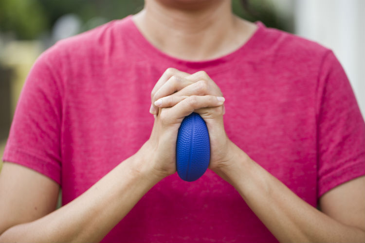 Caregiver squeezing a stress ball