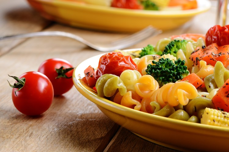 A plate of colorful pasta primavera