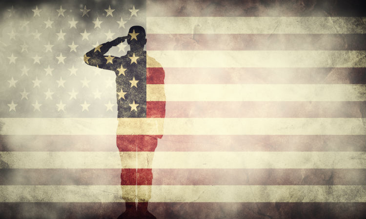 Silhouette of solider saluting american flag