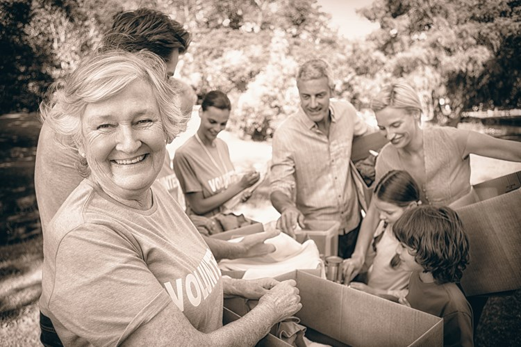 Senior woman smiling while actively doing volunteer work