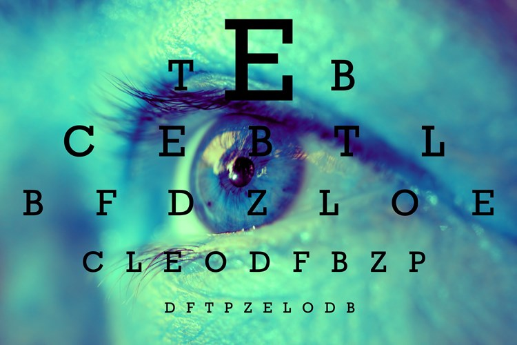 Eye chart with a close up of a human eye in the background