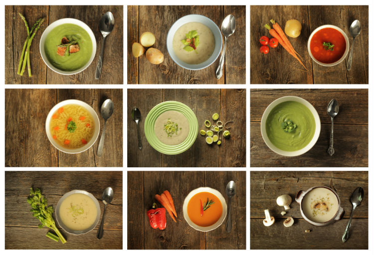 Different variety of pureed soup on wooden background