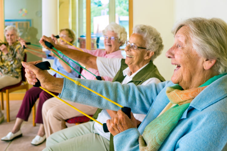 A group of senior women exercising at adult day care