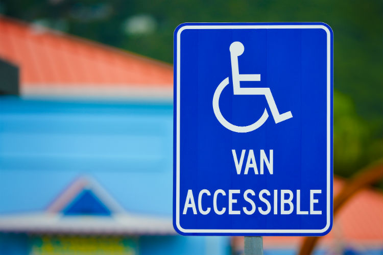 "Blue handicap sign that says ""van accessible"""
