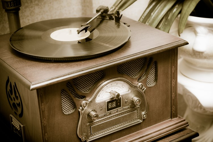 A close up of an old wooden record player