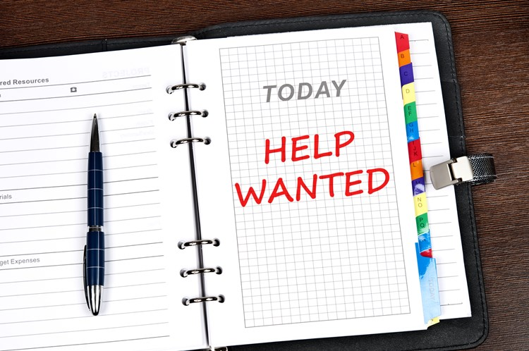 "Agenda open to today with the text ""help wanted"" written on the page in red"