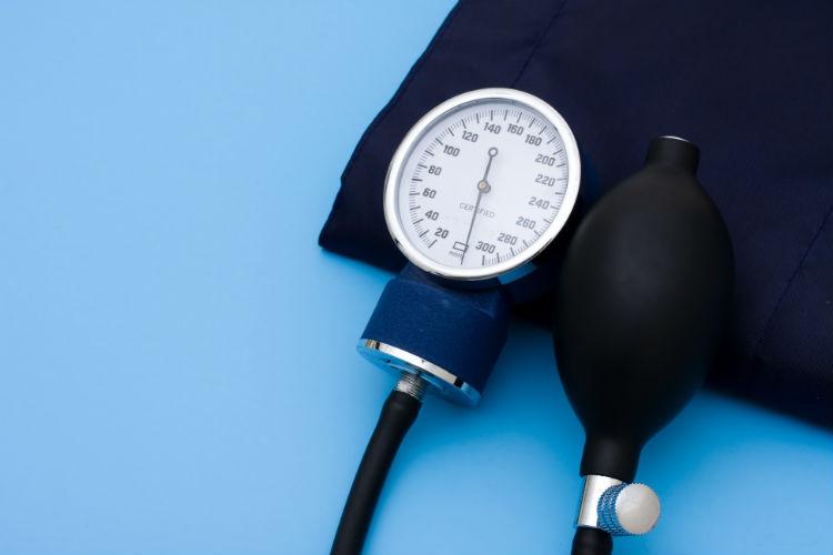 A blood pressure cuff on a blue background