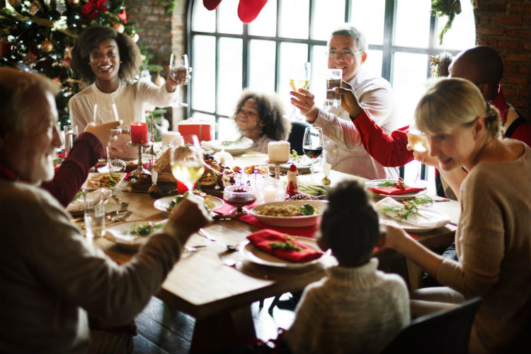 Family gathered around dinner table for holiday celebration