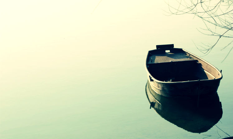 An empty row boat on a lake