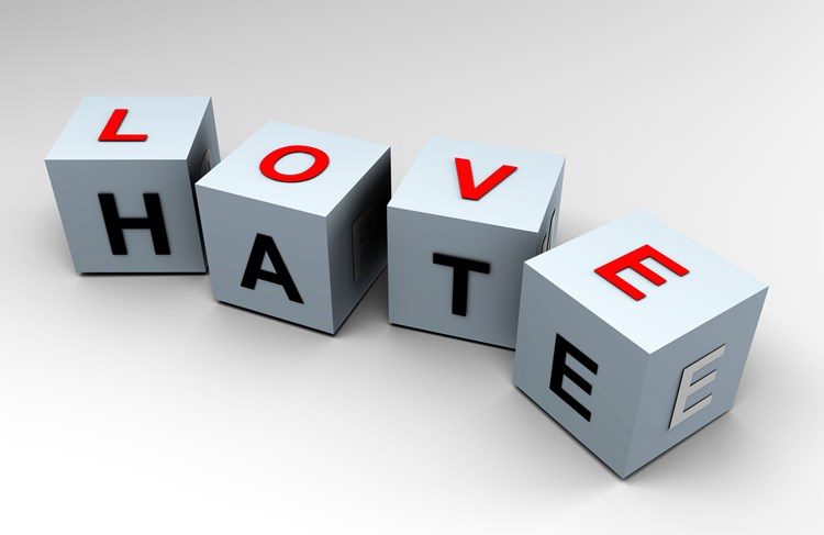 """four dice with letters on two sides that spell out two words """"love"""" and """"hate"""""""