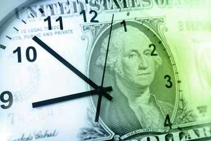 A wall clock with a one dollar-bill as the background image.
