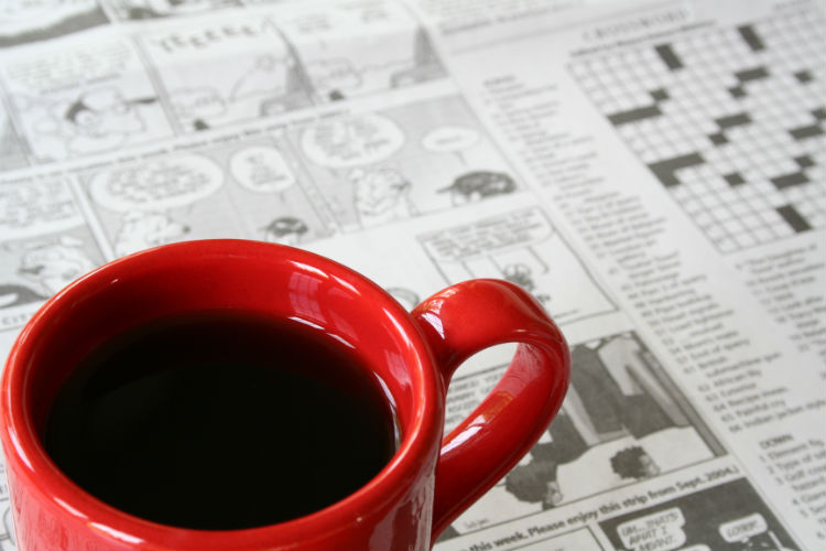 Coffee mug with newspaper comics