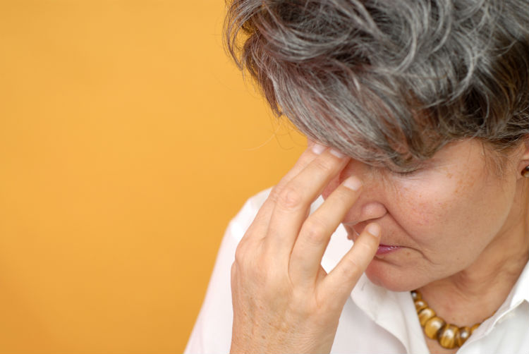 Older woman experiencing painful moment