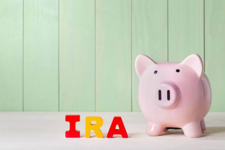 IRA in block letters beside a piggy bank