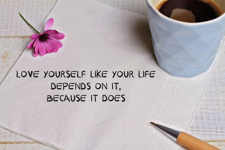 Cup of coffee on napkin with quote