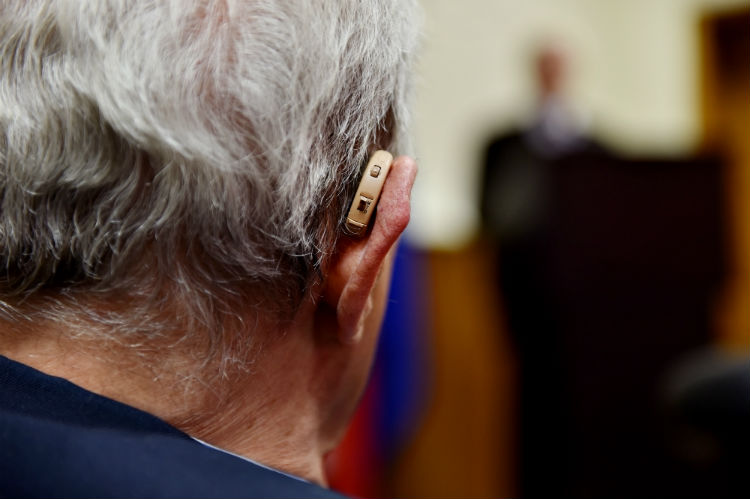 Close up view of man wearing a hearing device
