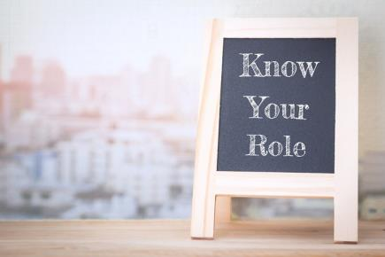 """Small chalkboard with text on it that reads """"know your role"""""""