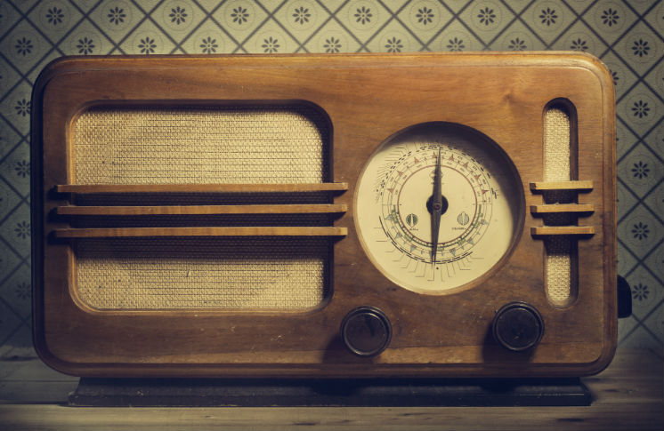A closeup of a vintage wooden radio