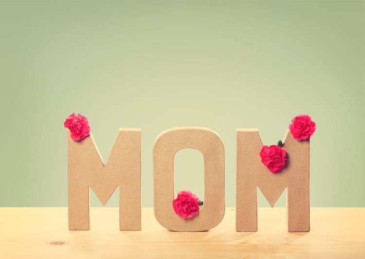 """Large letters that spell out """"Mom"""" with flowers on them"""