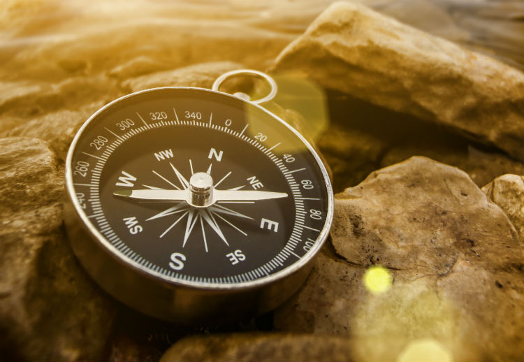 Compass on rocks