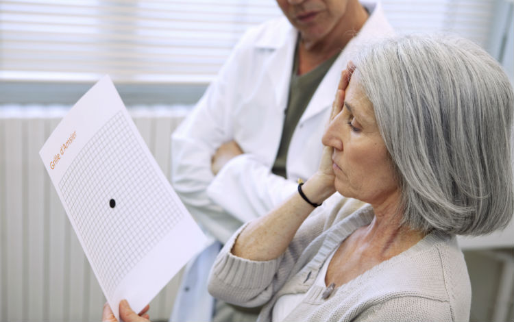 Woman taking an AMD test in her doctor's office