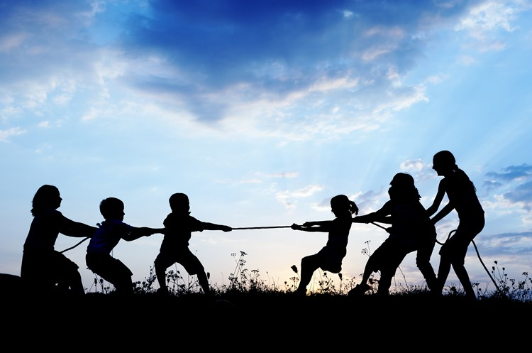 A family playing tug of war with a rope