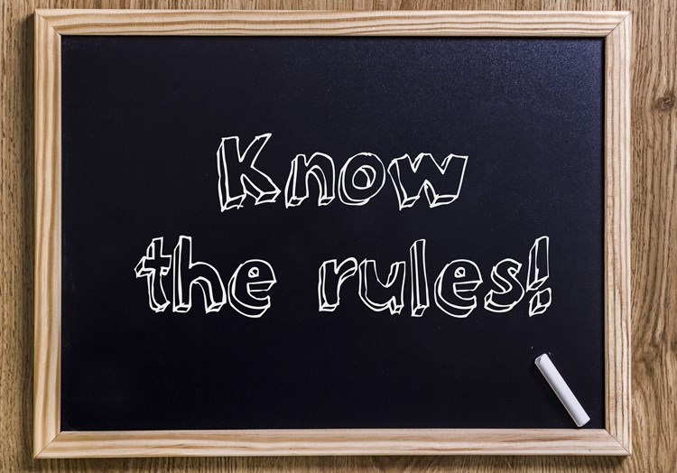 "Black chalkboard with text on it that reads ""know the rules"""