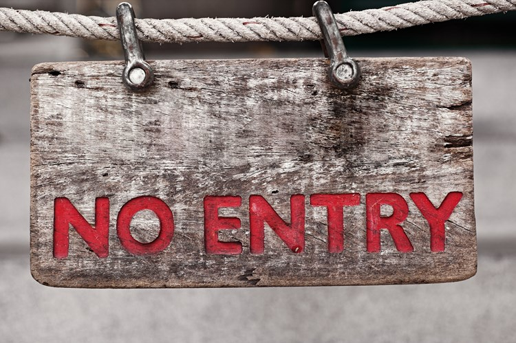 "Close-up of a wooden sign hanging on a rope that reads ""no entry"" in red letters"