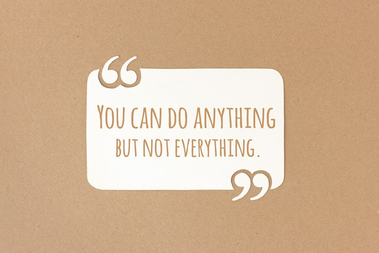 "A word bubble on a bulletin board with text inside that reads ""you can do anything but not everything"""
