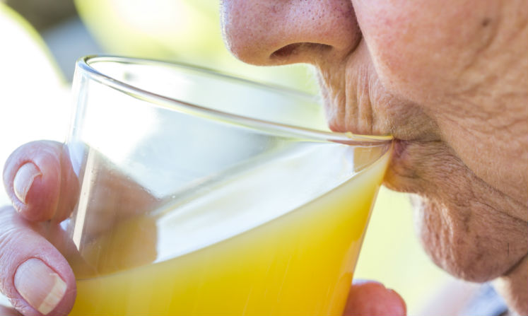 Close-up of a woman drinking juice