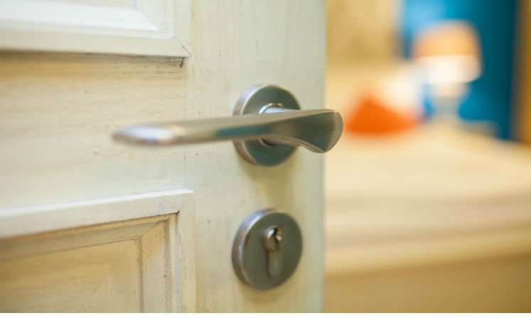 Close-up of a bedroom door knob and lock