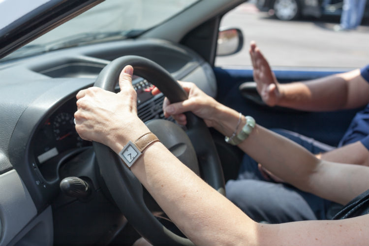 Woman driving car with male passenger