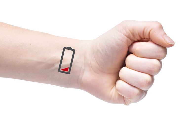 Arm extended with a low battery symbol displayed on inner wrist