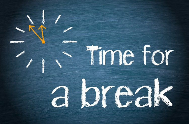 "A chalk board with the words ""time for a break"" written next to a clock"